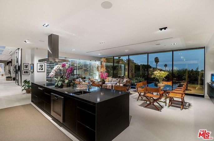 Open kitchen, dining area, and family room with wine display