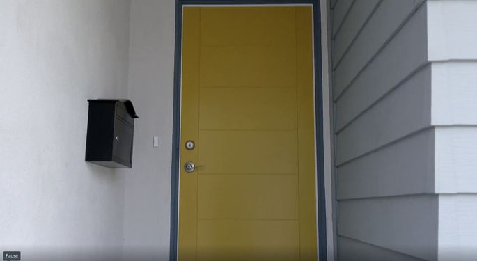 This yellow door was a bold choice, but it makes the house stand out.