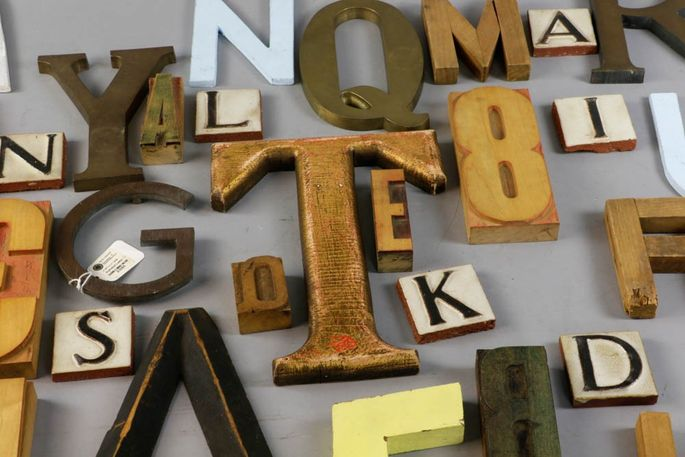 An assortment of printing blocks and wooden letters is up for auction.