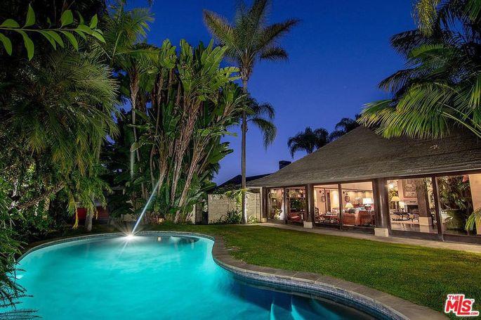 Grassy yard and pool