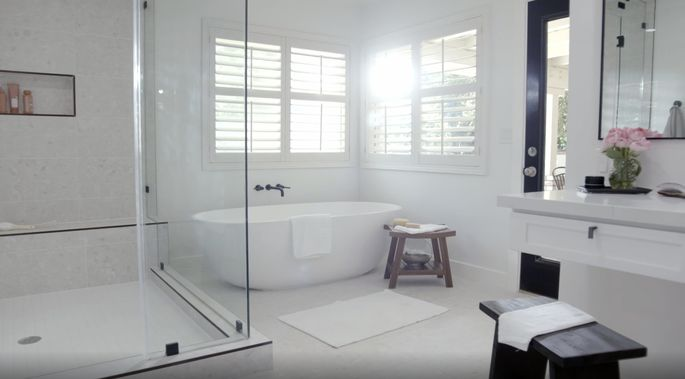 The steam shower looks perfect in this big bathroom.