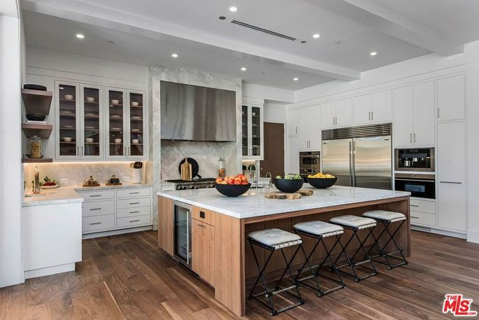 Kitchen with marble island with bar seating