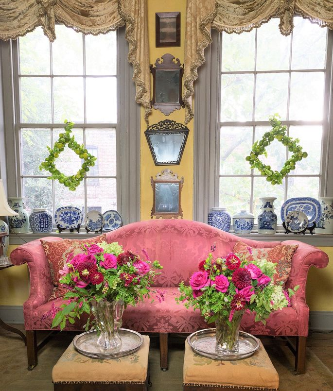 White House Back Parlor decorated with Christmas floral arrangements and lime wreaths