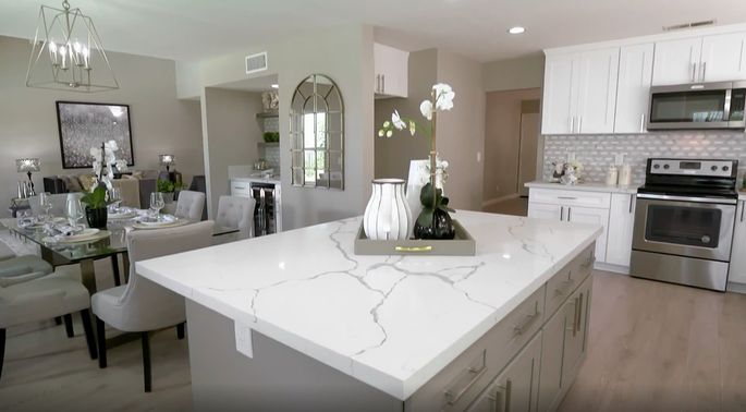 This gray island works perfectly with the white cabinets.
