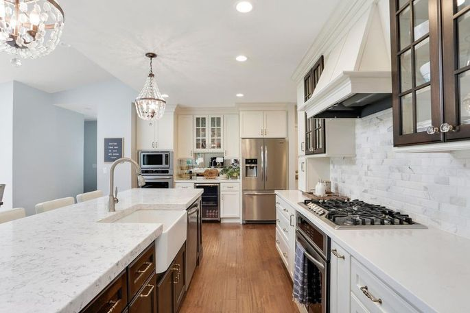 White kitchen with stainless-steel appliances