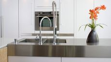 Are Stainless-Steel Countertops Right for Your Home? Advantages, Cost, and Care
