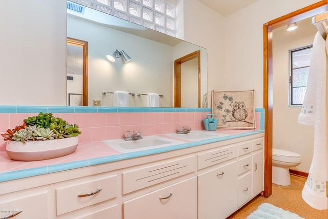 mid century pink bathroom