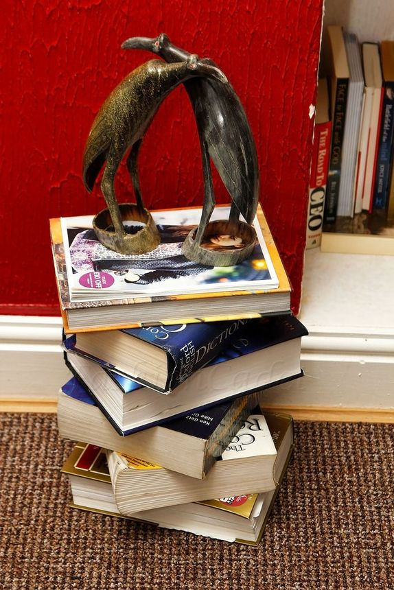 Carefully stack a bunch of books for a DIY side table.