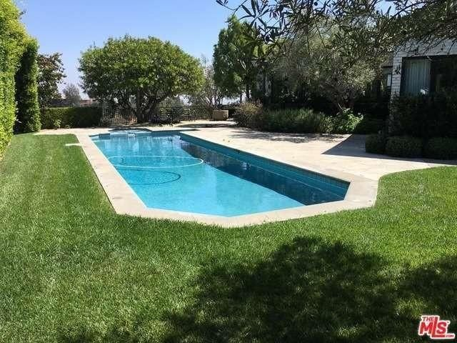 Emily blunt and john krasinski selling another socal home for Selling a house with a pool