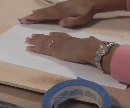 Use painter's tape to affix contact paper to a cutting surface.