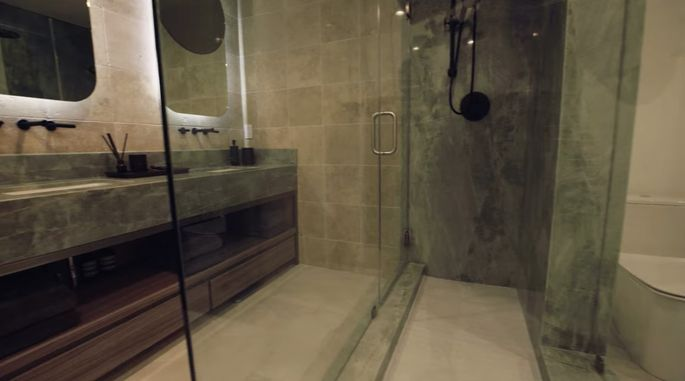 This glass shower makes the bathroom look incredibly chic.