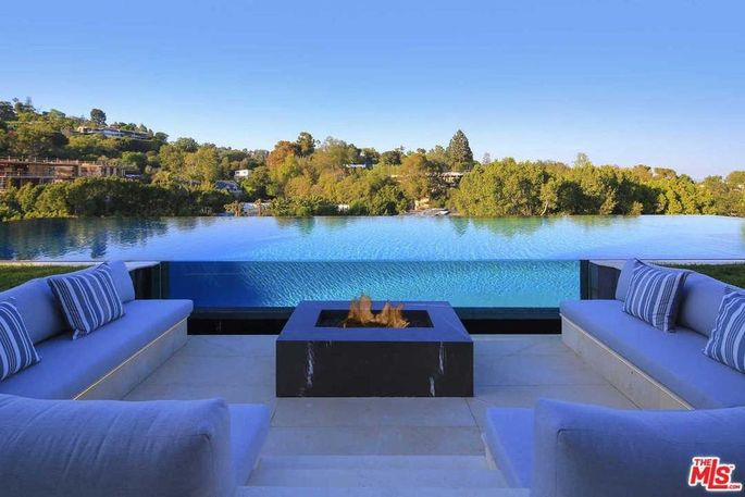 Infinity pool wall and fire pit