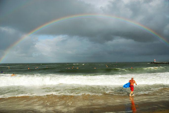 Surfing under a rainbow in Virginia Beach