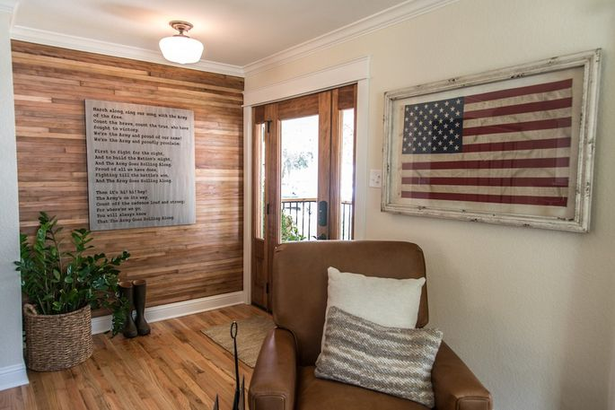 Chip and Joanna Gaines salvaged the wood floors to use on the wall of this Vietnam vet's remodeled home.