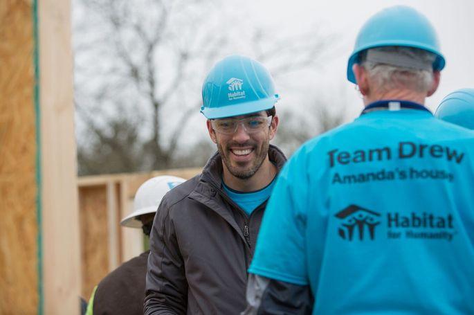 Drew working with Habitat for Humanity volunteers
