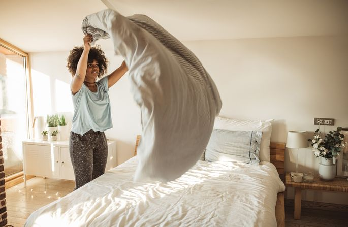 Start your day by quickly making the bed.