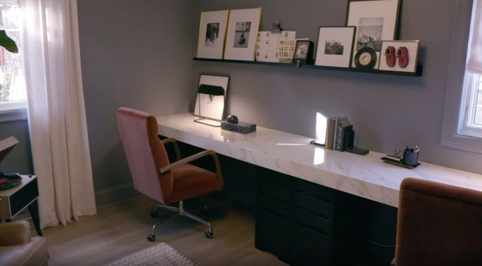 This wall-length desk is a stylish feature.