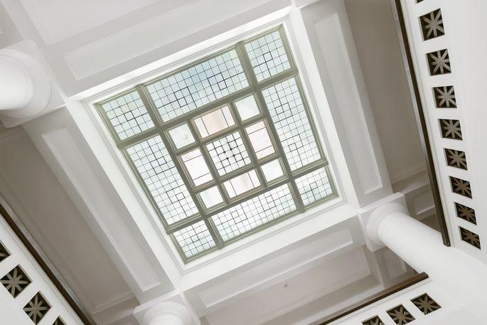 Square patterns shine through the atrium skylight