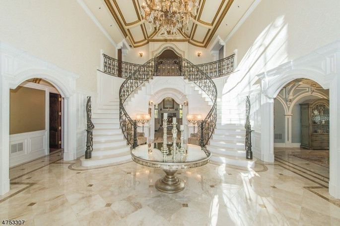 Grand foyer with chandelier anddouble staircase
