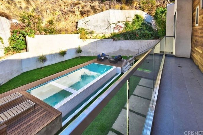 Back yard with infinity pool