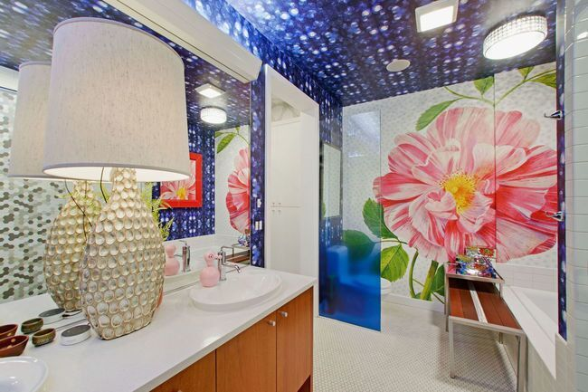 Master bath with giant flower wallpaper design