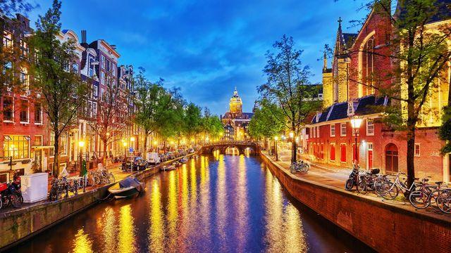 Canals run through Amsterdam.