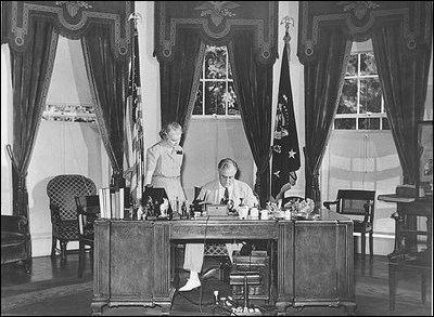 President Franklin D. Roosevelt meets with Marguerite Le Hand, his personal secretary.