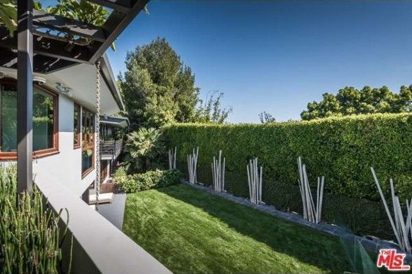 White bamboo poles frame Trent Reznor's garden.