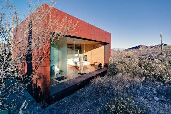 The Basics:Architect Rick Joyu0027sDesert Nomad Houseis A Set Of Three Rusted  Steel Cubes Nestled Within The Brush Of Tucson, Arizonau0027s Desert.
