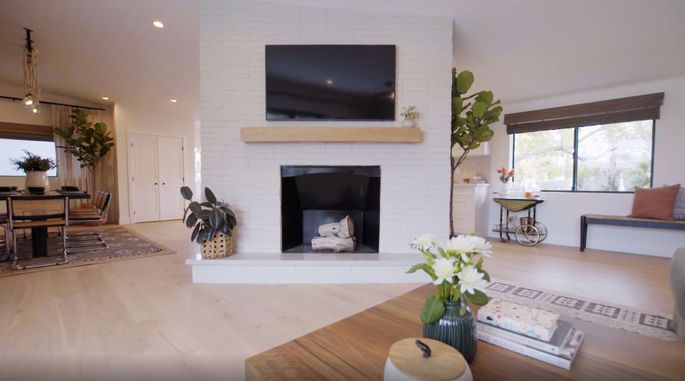 This clean and white fireplace looks much better.