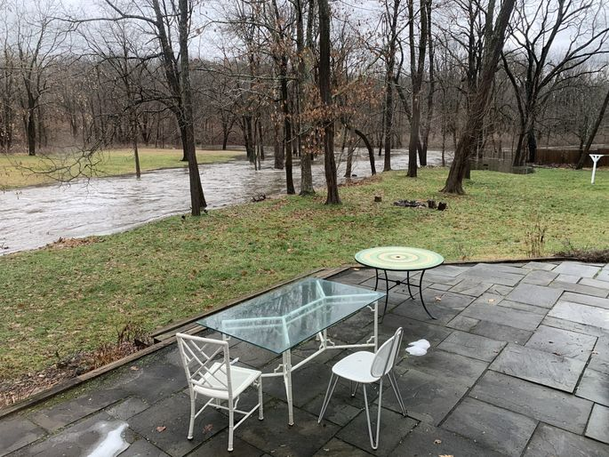 Our backyard patio is just steps from the creek.