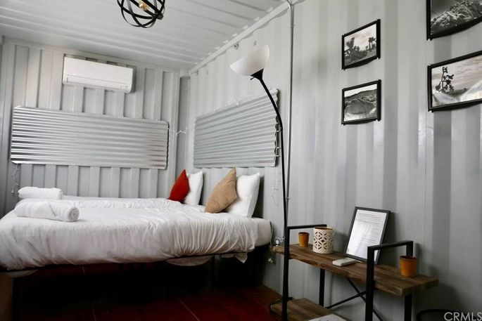 Shipping containers offer a guest bed and bath