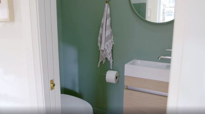 Drew and Jonathan are able to find a spot for this compact powder room.