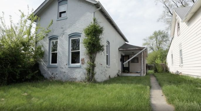 This house was covered with overgrown greenery.