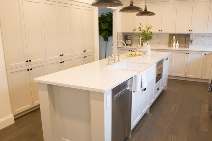This newly remodeled kitchen has added storage space along the back wall.