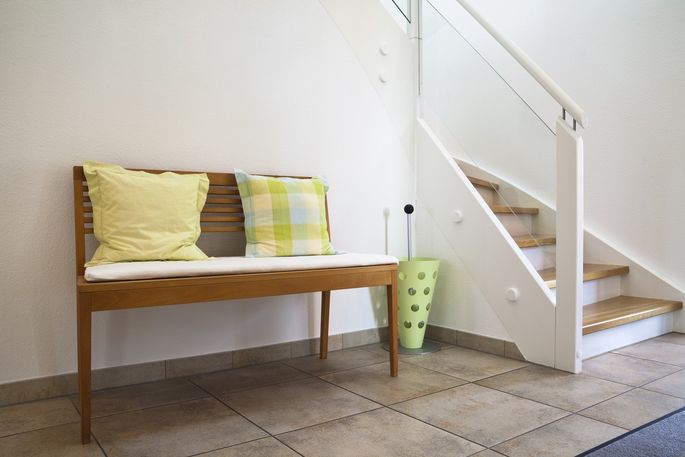 A bench in your foyer serves as a place to put on or takeoff your shoes.