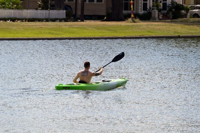 A kayaker paddles down the Bayou St. John at the edge of Mid-City.