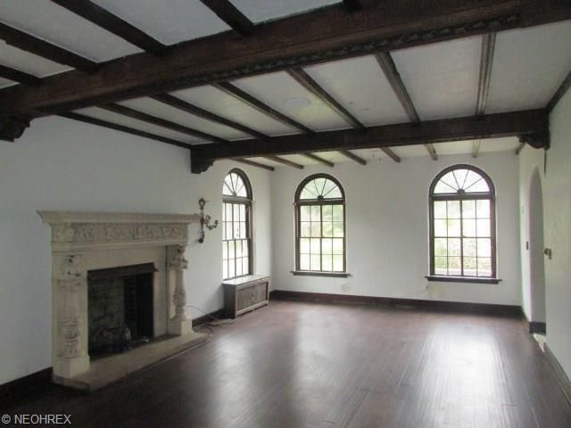Beamed ceiling and antique fireplace