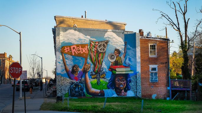 A mural depicting the uprisings following the death of Freddie Gray in Sandtown-Winchester