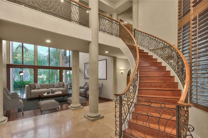 Wrought-iron accents adorn the staircase.