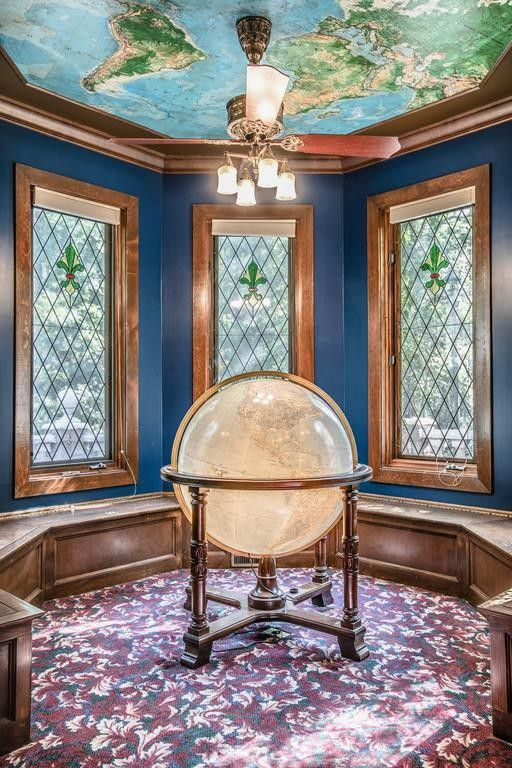 An illuminated globe comes with the house, with a map of the world overhead.