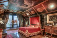 Inside This Unassuming Suburban Home Lurks an Unbelievable Castle