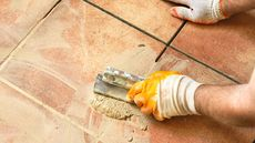 How to Regrout Tile in Your Kitchen, Bathroom, and Beyond