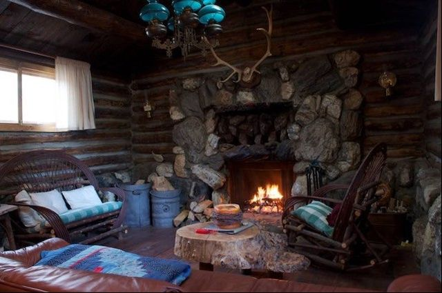 Huge fireplace in one of the historic cabins