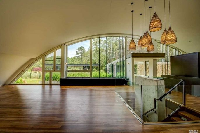 Open living space with floor-to-ceiling windows