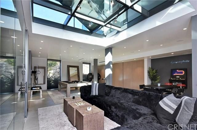 Lower-level entertaining area with skylights