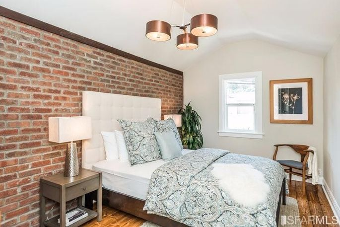 Bedroom with decorative brick wall