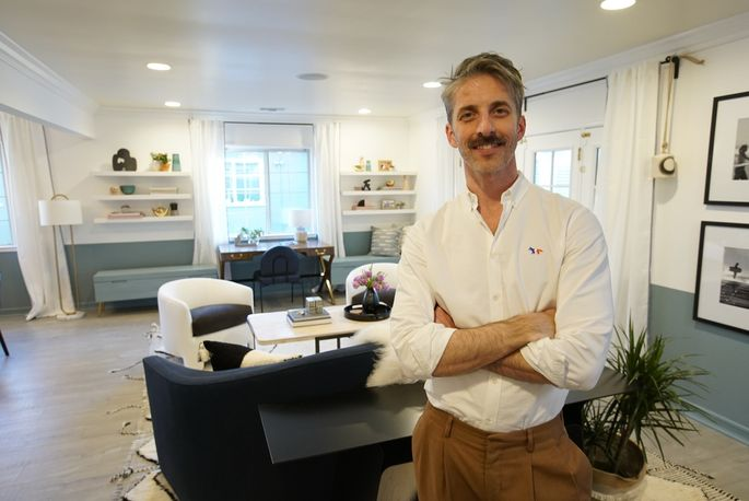 Mat Sanders in his newly designed great room (note the chic storage benches behind him)