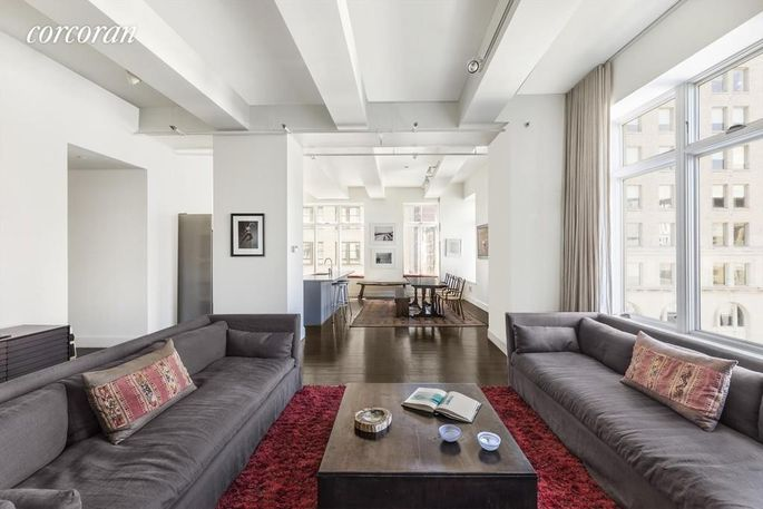 Living space with beamed ceilings in Manhattan condo