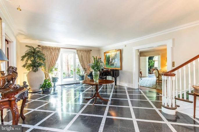 Entry with inlaid marble floor